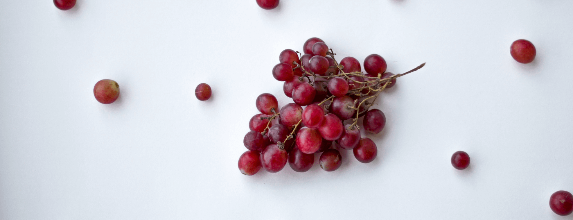 Red grapes on a white table