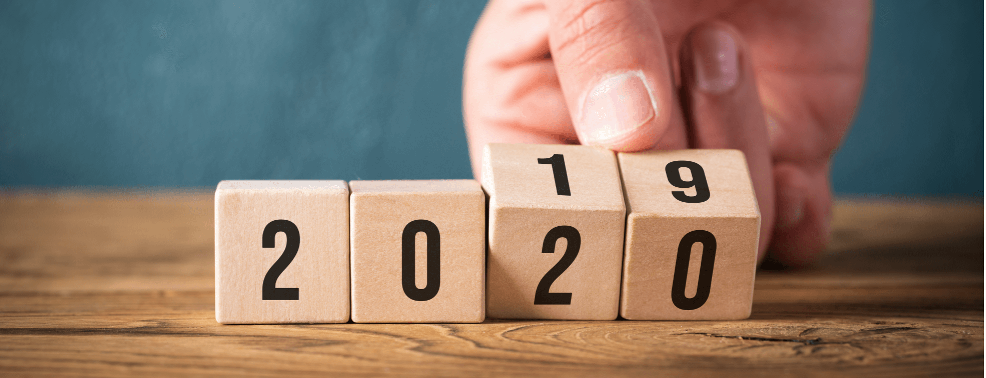 Person turning cubes with number from 2019 into 2020