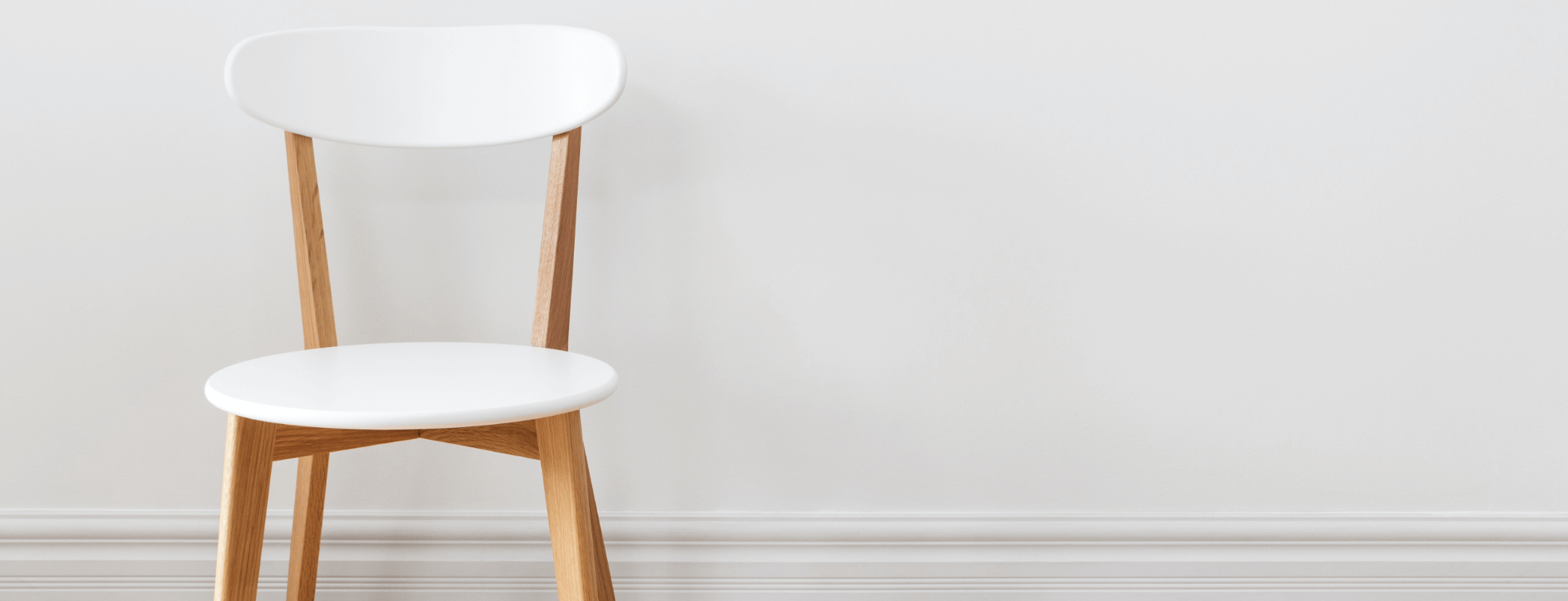 Traditional looking white chair on a white background