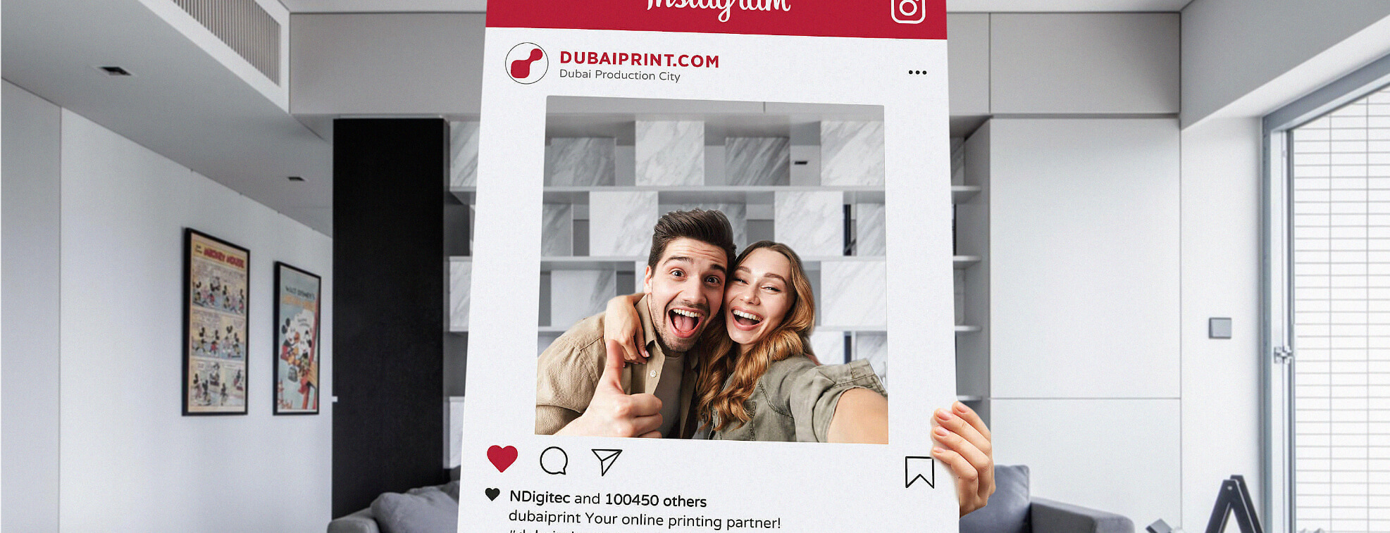 Couple looking cheerfully through a custom made instagram frame