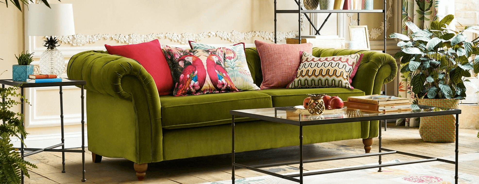 Bohemian interior design with many bright pillows